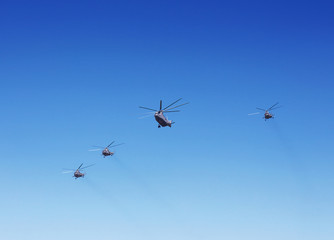 Transport helicopters in flight.