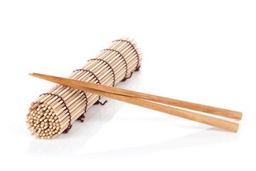 Chopsticks over bamboo mat