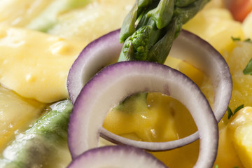 Asparagus baked with cheese served with buttered potatoes.