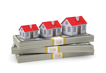 Small houses stand on pack of dollars