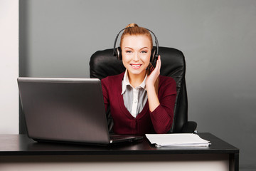 Portrait of smiling beautiful young call center operator in