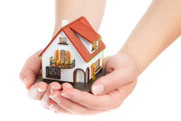 house in hands - real estate concept