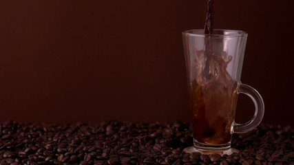 Hot coffee pouring into glass
