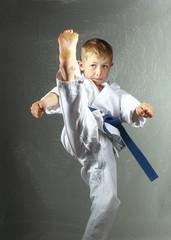 Sportsman in karategi is  beating direct high kick leg