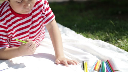 Child painting in the park