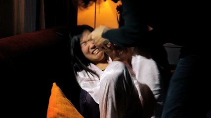 Domestic violence husband hitting asian wife