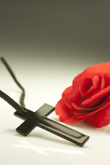 crucified and red flower