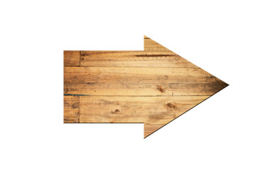Directional arrow made of old wood surface.