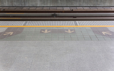 Arrow on floor at sky train