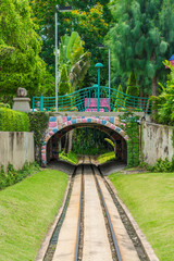 Cute dreamy railway tunnel path under the bridge