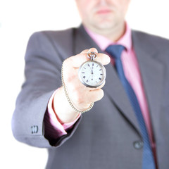 The man holds pocket watch in hand