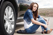 Female driver waiting for roadside assistance