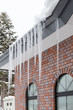 The ice on the roof of the brick house - 64890013
