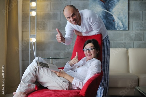 young couple using Laptop computer at home
