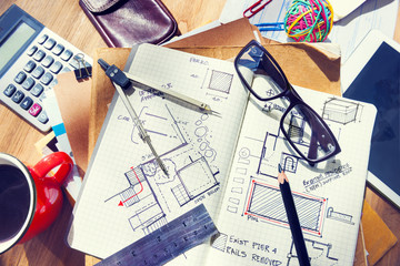 Designer's Desk with Architectural Tools and Blueprint