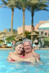 Senior couple at pool