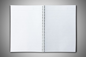 Blank black cover notebook open on gradient background