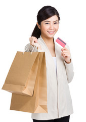 Woman holding shopping bag with credit card