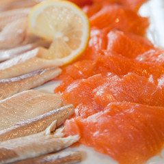 Smoked salmon and fish fillets on a buffet