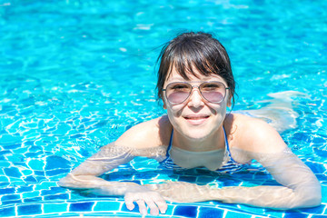 Young girl  floating in the pool
