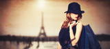 Redhead women with shopping bags on parisian background. - 64894478