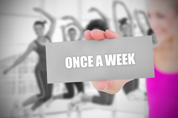 Fit blonde holding card saying once a week