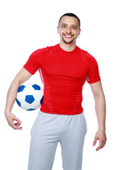 Crazy sportive man holding soccer ball over white background