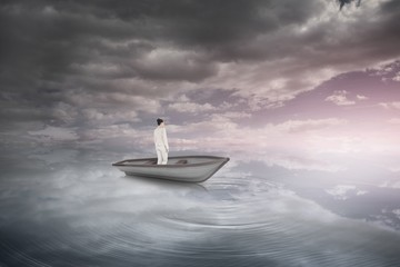 Composite image of asian businesswoman in a sailboat