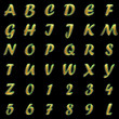 golden alphabet on black background