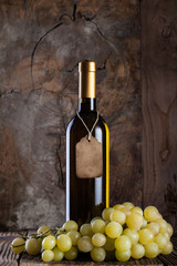 White wine with vintage tag and grapes