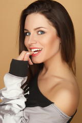 beautiful smiling girl in a hoodie posing