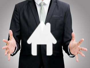 Businessman standing posture hand holding house icon isolated