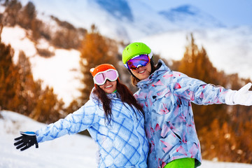 Portrait of young man and woman in ski masks