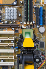 Robotic arm installing computer chip