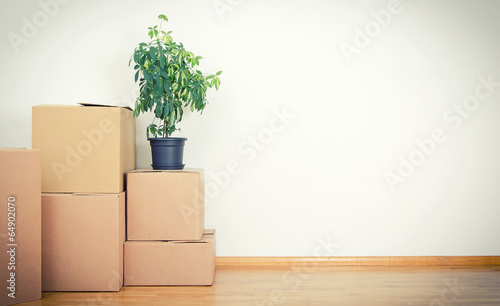 New home concept. Boxes in empty room. - 64902070