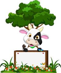 Cute cow cartoon on flower garden with blank board