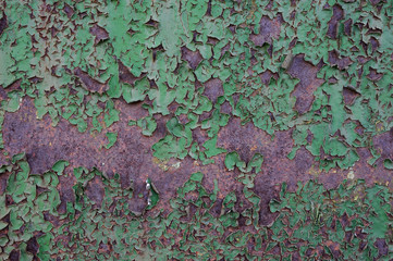 green paint on a rusty metal