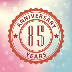 85 Years Anniversary-Retro seal, with colorful bokeh background
