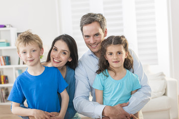 portrait of a beautiful family at home
