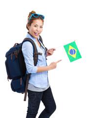 Female traveler holding Brazil flag