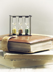 stack of books and hourglass