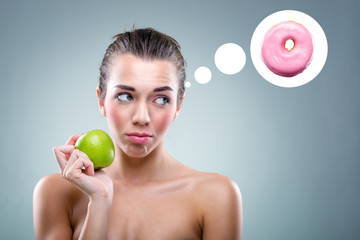 The Diet! Woman eating an apple , but he thinks a donut .