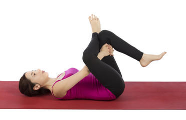 Woman doing Eye of the Needle Pose