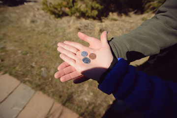 Coins on Palms