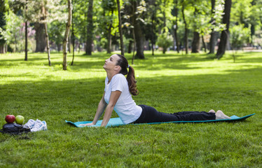 Girl Stretching in a Green Park