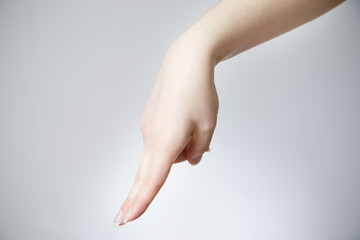Female hand on a gray background