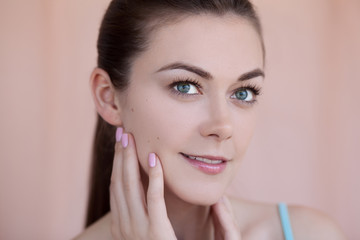 Beautiful young woman with natural daily makeup and manicure bea
