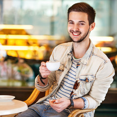 Young fashion man with beard drinking espresso coffee