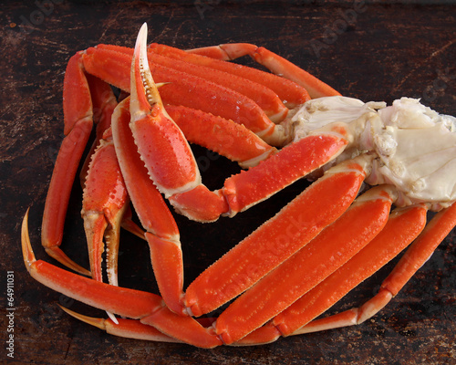 Fotobehang Schaaldieren Crab legs on brown background