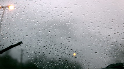 Windscreen wiper wiping rain away from car window